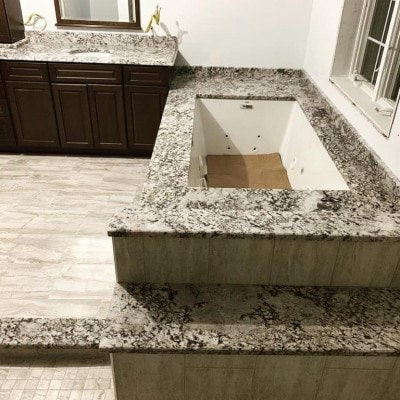 Gorgeous Granite Whirlpool Tub Surround and Vanity