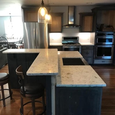 Granite Countertops with Unique L-Shaped Island