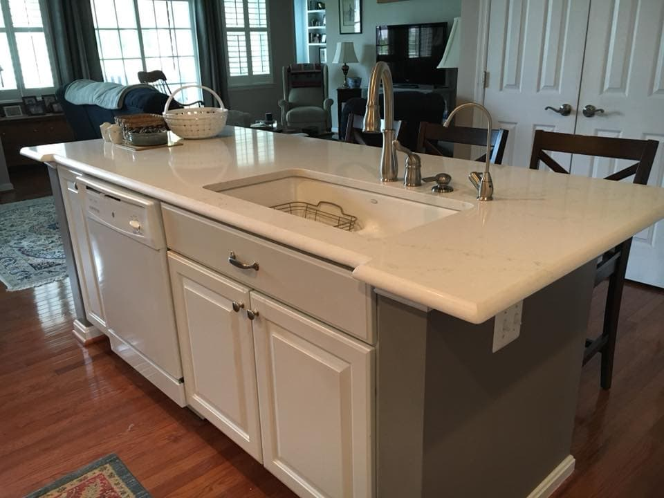 White Granite Island With White Undermount Sink and Specialty Edge