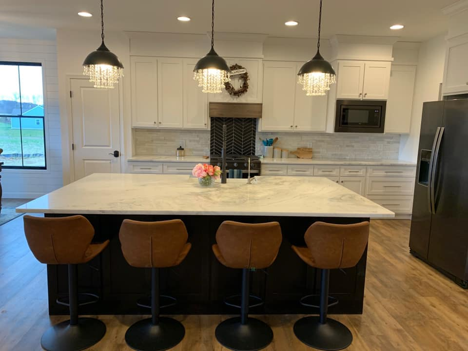 Straight view of mont blanc marble kitchen island.